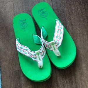 Green reef sandy flip flops